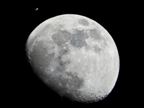 The International Space Station can be seen as a small object in the upper left of this image of the moon in the skies over the Houston area flying at an altitude of  kilometers January