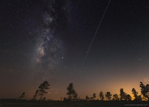 The International Space Station flies alongside the Milky Way as seen from Central Florida yesterday evening