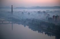 The Juche Tower rises high above the morning mist along the Taedong River in Pyongyang North Korea Wong Maye-E