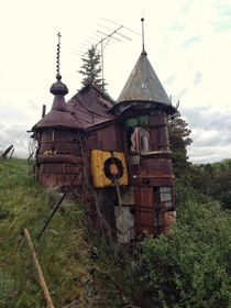 The Junk Castle - built in the s by art teacher Victor Moore out of junk windows are recycled washing machine glass etc in Whitman County Washington