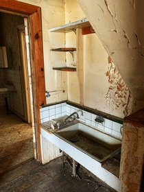 The kitchen in an old farmhouse no stove no counter tops just a pantry off to the side