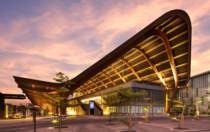 The Kutubu Convention Centre is an iconic yet highly functional design defined by a signature roof inspired by Papua New Guineas traditional timber long houses which form the heart of the countrys rural villages