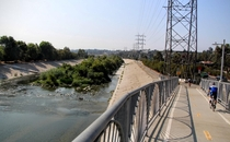 The LA River was paved over after a catastrophic flood in  In recent years there have been efforts to partially restore it like in the Glendale Narrows shown here