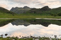 The Langdale Pikes reflecting in Blea Tarn The English Lake District