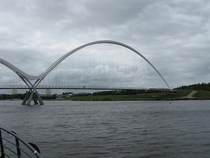The large northern arch of the Infinity Bridge Stockton-on-Tees UK