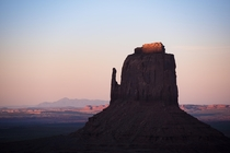The last bit of sunset light hitting the top of East Mitten Monument Valley Navajo Nation AZUT USA