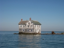 The last house on Holland Island in the Chesapeake Bay as it stood in October  This house fell into the bay in October