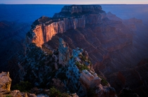 The last rays of sunset Illuminate Wotans Throne the Southernmost tip of the Walhalla Plateau on the North Rim of the Grand Canyon A thousand feet higher in altitude than the South Rim this point affords a commanding and majestic view of the Grand Canyon