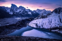 The lights of the dawn color the peeks of Mount Everest view from the still half frozen Gokyo lake m high ft in early May  Photo by Jared Lim