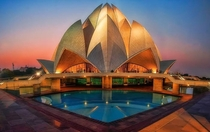 The Lotus Temple in New Delhi India It composed of  free-standing marble-clad petals arranged in clusters of three to form nine sides with nine doors opening onto a central hall