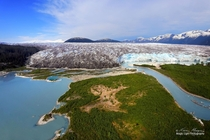 The magnificent Taku Glacier near Juneau Alaska is recognized as the deepest and thickest alpine temperate glacier known in the world It is also apparently one of the few glaciers that is still advancing despite global warming