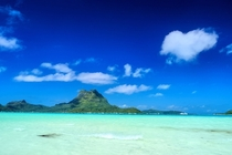 The many blues of beautiful Bora Bora shot from Paul Gauguin Cruises private beach last week