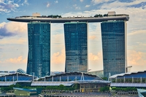 The Marina Bay Sands Hotel Singapore not the drone just to the left of the middle tower and plane near the left-most tower