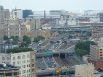 The Mass Pike and the train line running from Back Bay to South Station in Boston The Southeast Expressway is visible running perpendicular
