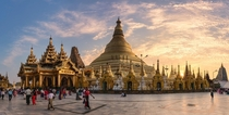 The massive  meter high gold plated Shwedagon Pagoda in Yangon also known as the Golden Pagoda has its main stupa surrounded by  small stupas Historical evidence suggests the pagoda was built around the th century