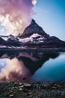 The Matterhorn in clouds with its reflection  x