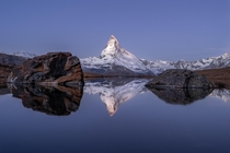 The Matterhorn is reflected in the Stellisee about one hour before sunrise