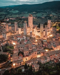 The medieval skyline of San Gimignano a walled hill town with towers dating back to the th century in Siena Tuscany Italy
