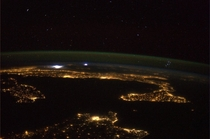 The Mediterranean the Pleiades and a storm in the distance  Photo taken from ISS by astronaut Luca Parmitano