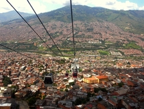 The MetroCable gondola system high above Medelln Colombia Cable cars are an important part of the mass transit system in this mountainous city connecting far-flung suburbs and carrying  riders a day