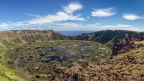 The mile-wide crater lake of Easter Islands extinct Rano Kau volcano  photo by Greg Ness