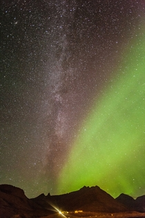 The Milky Way and the Aurora Borealis photographed above Faskrudsfjordur Iceland a couple of nights ago