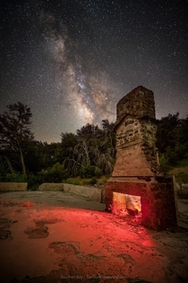 The Milky Way and the remains of an abandoned building burned down in the massive  Cedar Fire San Diego County