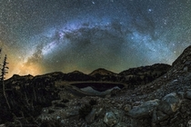 The Milky Way arches over Mt Lassen and Lake Helen in Lassen Volcanic National Park in Northern California
