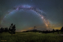 The Milky Way arching over Devils Tower in Wyoming Photo by David Lane