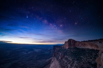 The Milky Way being chased away by the light of dawn in Canyonlands National Park Utah