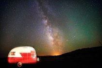 The Milky Way blazing above a camper at Lyman Lake in eastern Arizona