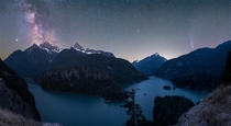 The Milky Way core and Comet Neowise over Diablo Lake Washington