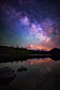 The Milky Way galaxy as drifts beyond Mt Hood as seen from the beautiful Lost Lake in Oregon