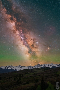 The Milky Way Jupiter Saturn and atmospheric airglow all captured in one image rising over the San Juan Mountains in Colorado