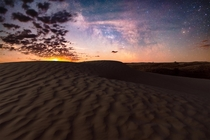 The milky way moonrise and sand dunes in the Great Sandhills in Saskatchewan