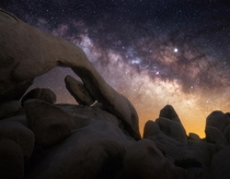 The Milky Way over a cool rock formation in Joshua Tree National Park