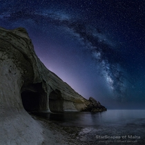 The Milky Way over Sea Caves at Pellegrin Point limits of nejna Malta by Gilbert Vancell