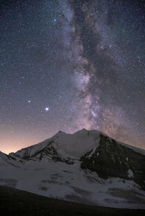 The Milky Way over the Weisshorn one of the highest and most dangerous mountains in Switzerland Photographed at an altitude of m