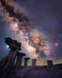 The Milky Way rises over limestone formations in California