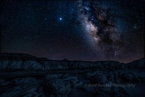 The Milky Way rises over the alien landscape of Bisti Badlands New Mexico x OC