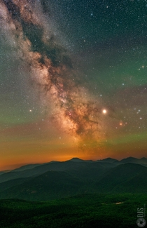 The Milky Way rising amongst oodles of atmospheric airglow atop the Adirondack Mountains in NY