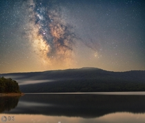 The Milky Way rising high above the Catskills Mountains  this is a two shot blend with one tracked and one untracked shot to bring out more detail in our night sky
