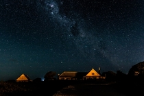 The Milky Way rising over an old whaling station in Kaikoura New Zealand