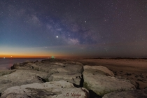 The MilkyWay with the Jupiter and Venus fading away in the predawn sky over the Jetty in Barnegat New Jersey