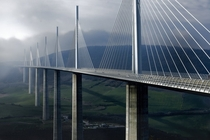 The Millau Viaduct - a multi-span cable-stayed bridge completed in  across the gorge valley of the Tarn in Southern France Designed by French engineer Michel Virlogeux and English architect Norman Foster As of July  the tallest bridge in the world with a