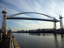 The Millennium Bridge at Salford Quays fully raised to allow ship traffic through