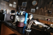 The Monk bobble head and burnt snow globe left behind after a large fire destroyed an office building in Chicago