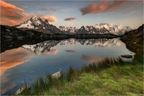 The Mont Blanc massif reflecting into Lac de Chsery Switzerland  by Christian Klepp
