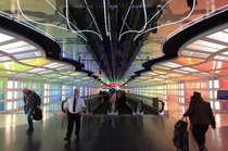 The Moodlit Chicago OHare Moving Walkway Tunnel