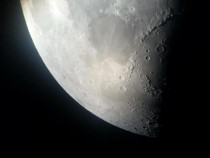 The moon looks good through my fathers telescope x
